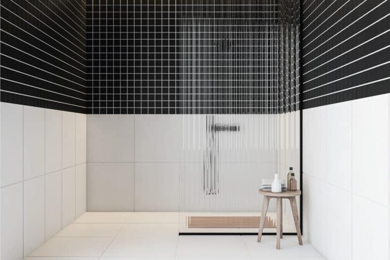Black and white tiled shower in bathroom with shower bench, How Much Does A Shower Bench Cost?
