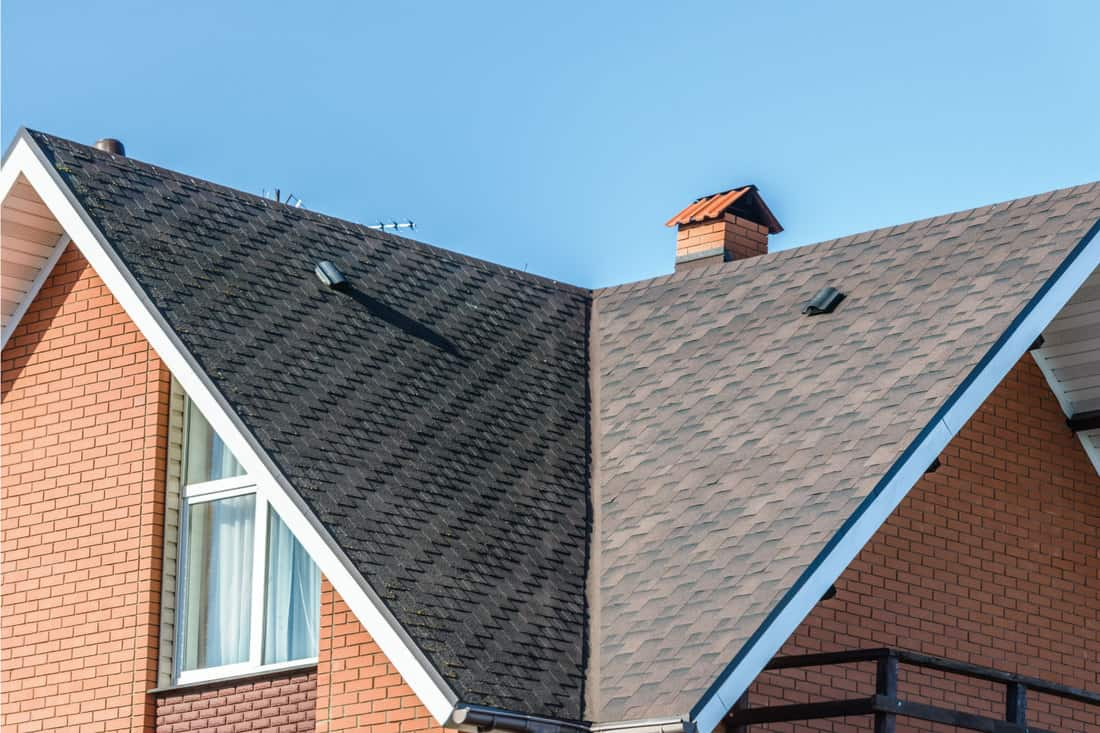 Black asphalt roof shingles on a house roof