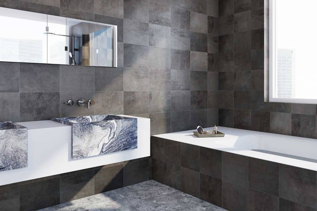 Black tiled bathroom corner