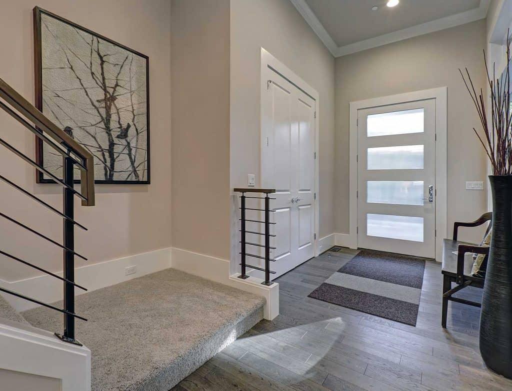 Bright entryway with creamy walls and hardwood floor