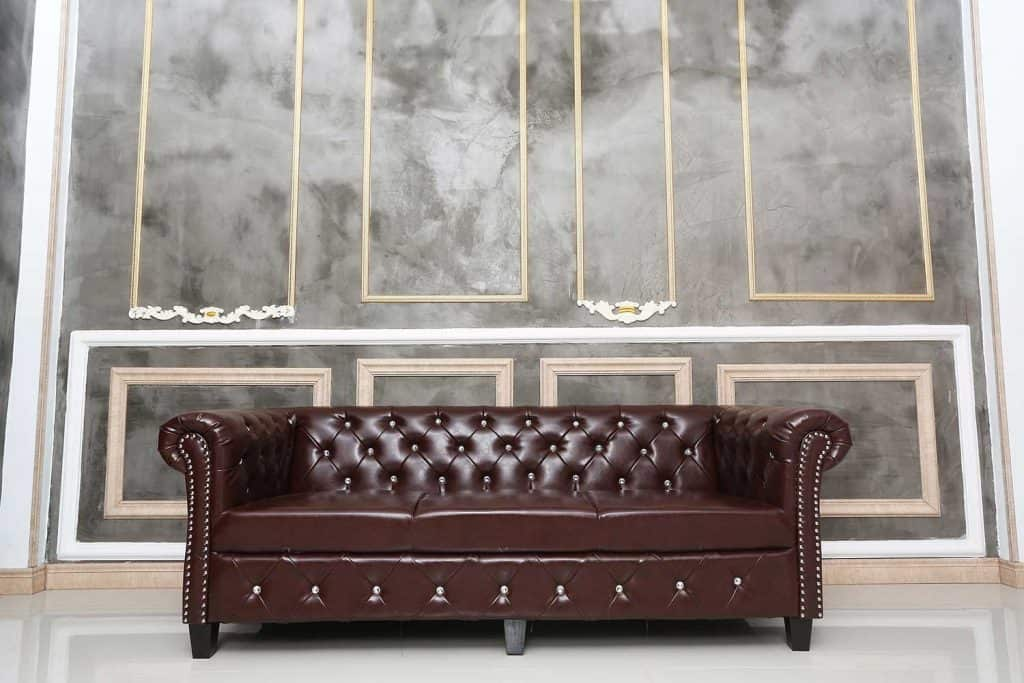 Brown leather sofa in the room