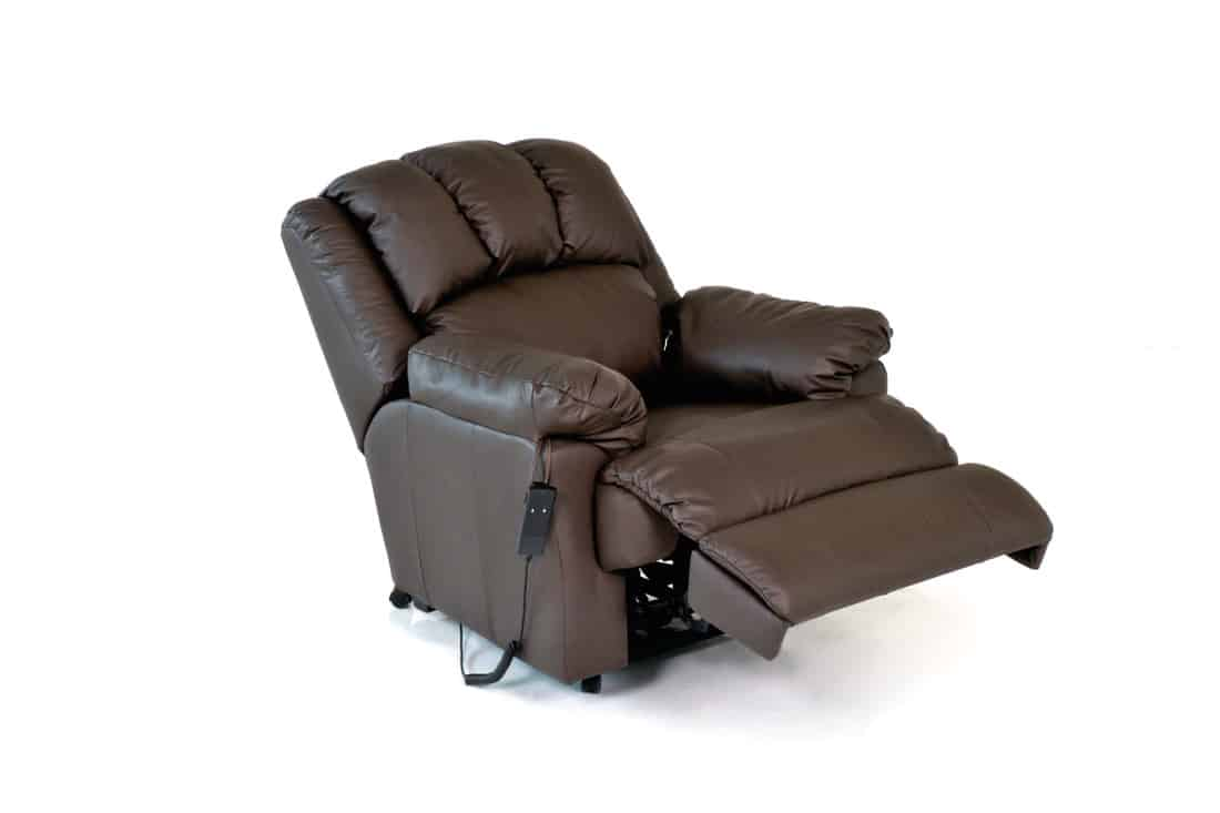 Brown reclining leather chair isolated in white