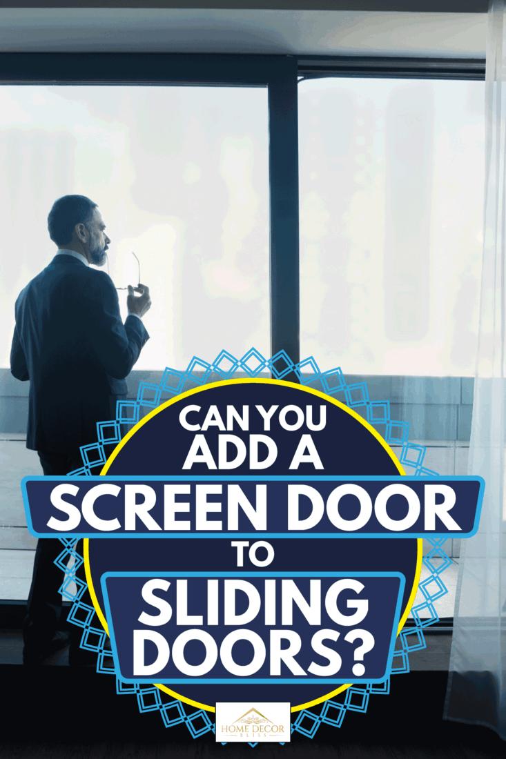 Businessman looking through sliding door with screen door, Can You Add A Screen Door To Sliding Doors?