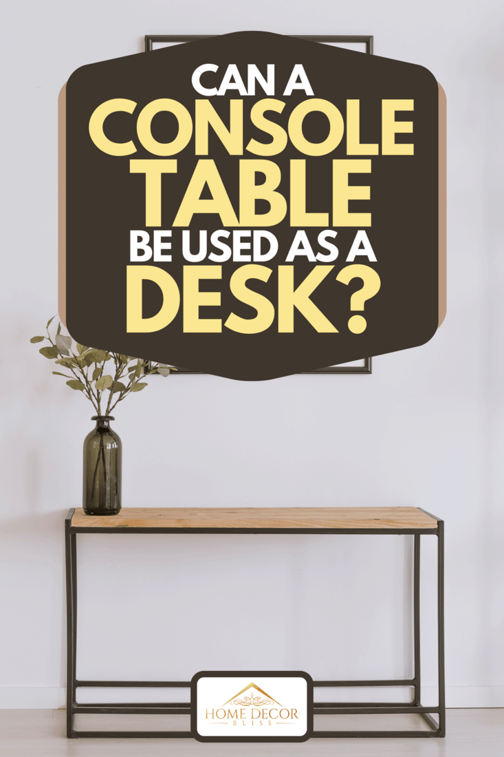 A simple painting above wooden console table with twigs in a glass vase in modern living room interior, Can A Console Table Be Used As A Desk?