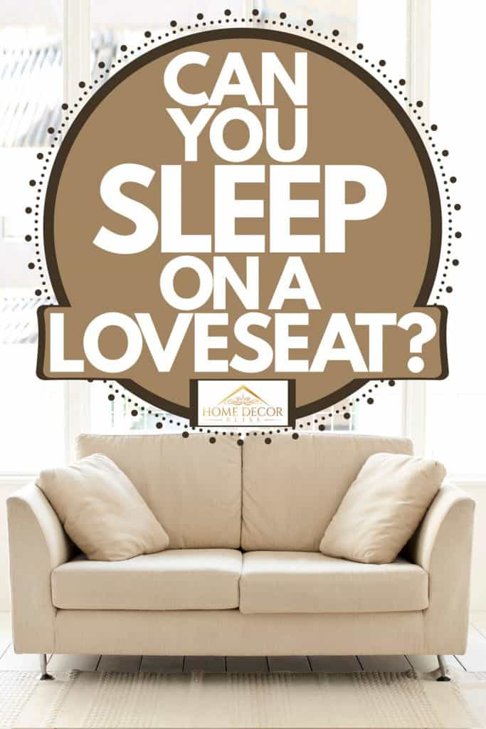 A cream colored loveseat inside a white living room, Can You Sleep On A Loveseat?