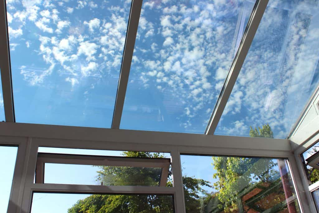 Clear tempered glass sunroof with metal framing