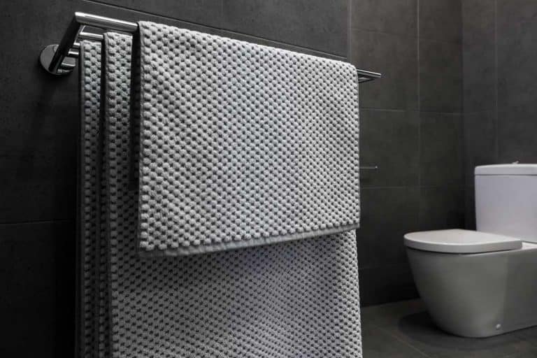 Close up of luxury bathroom towels in a monochrome ensuite bathroom, How High To Hang A Towel Bar?