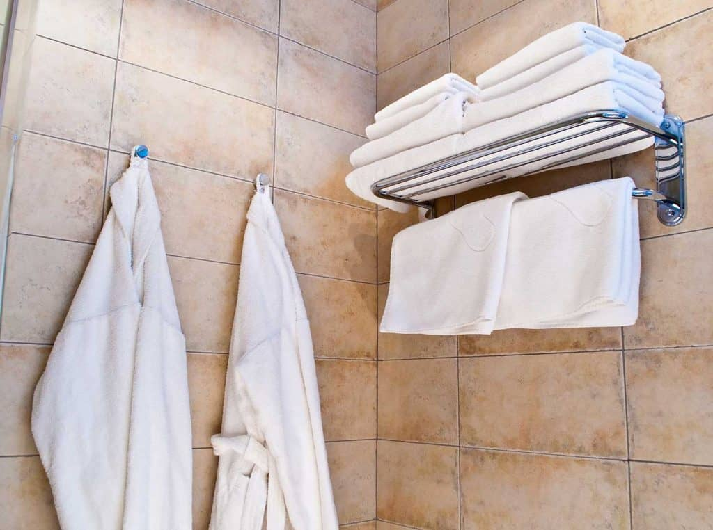 Close up of white bathrobes and towels