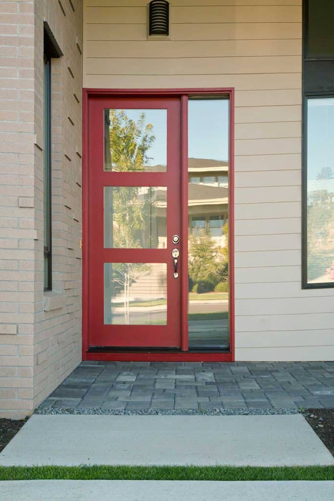 Closed modern red exterior door of a home