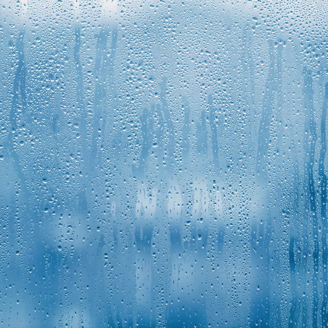 Condensation on glass window with water drops
