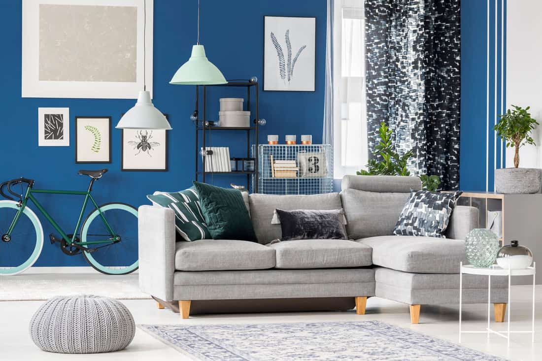 Cozy corner sofa with velvet pillow with tassels in navy hipster room, 9 Best Sofas For Short People