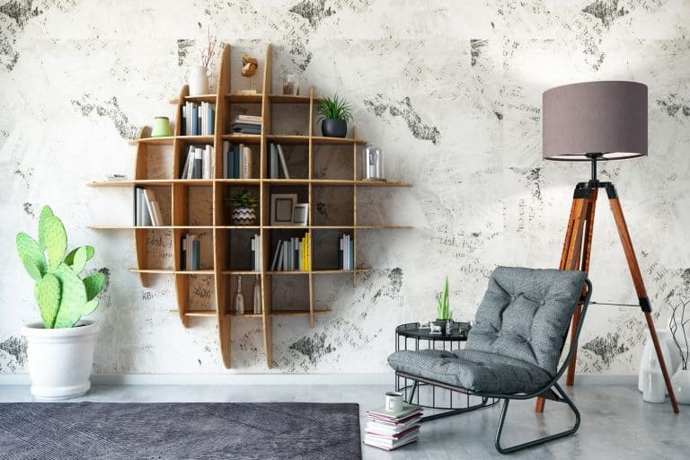 Creative Bookshelf Design with Armchair in living room, How To Stop A Bookcase From Tipping Over