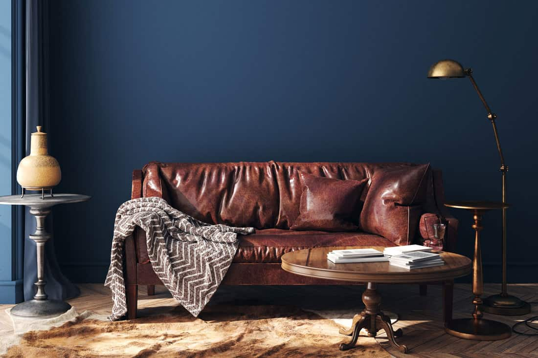 Dark blue hipster style home interior with old retro furniture