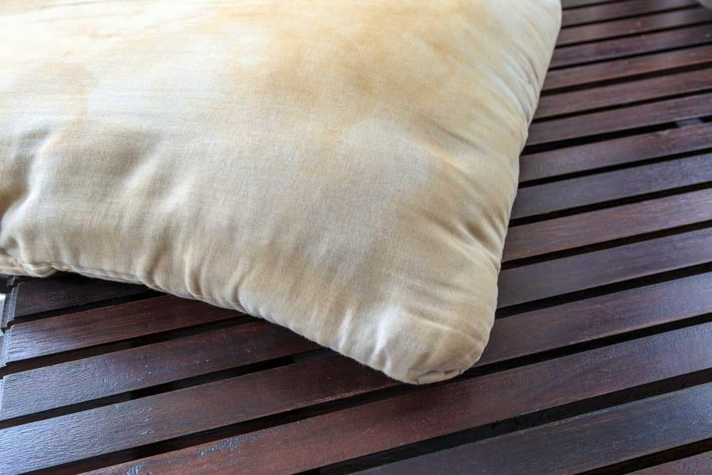 Dirty pillow on wooden table