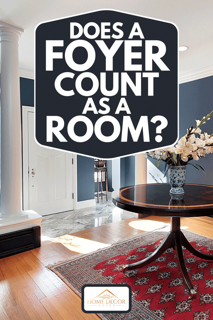 Foyer with white columns and round center table, Does a Foyer Count as a Room?