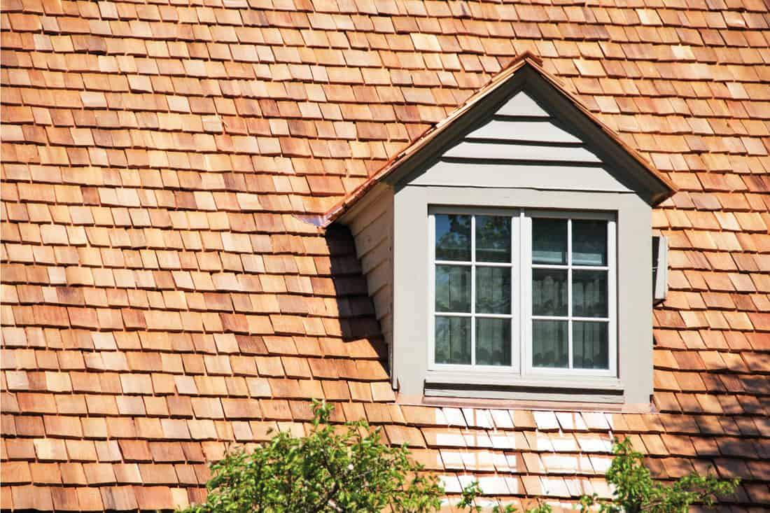 Dormer in roof of house with cedar shingles
