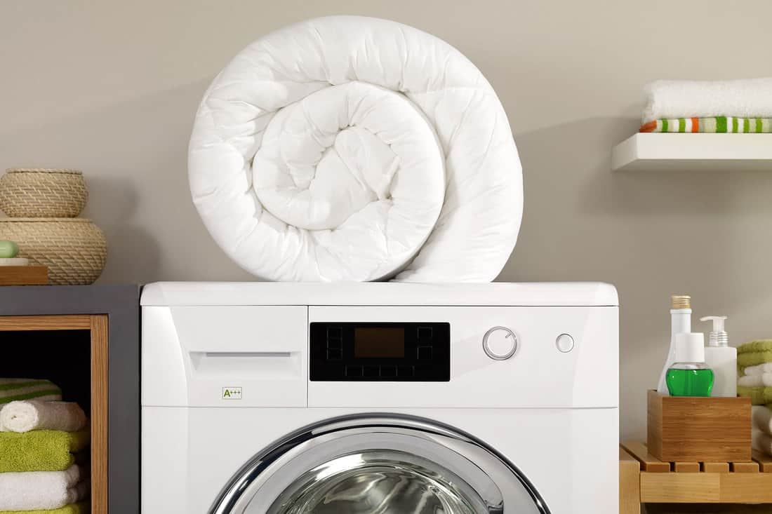 Folded newly washed white comforter in a laundry room, How To Make Comforter White Again