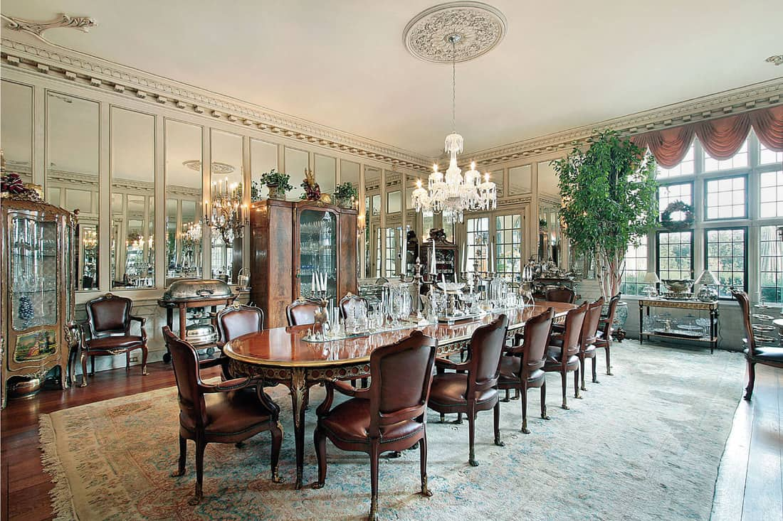 Formal dining room with wall of rectangular full-sized mirrors