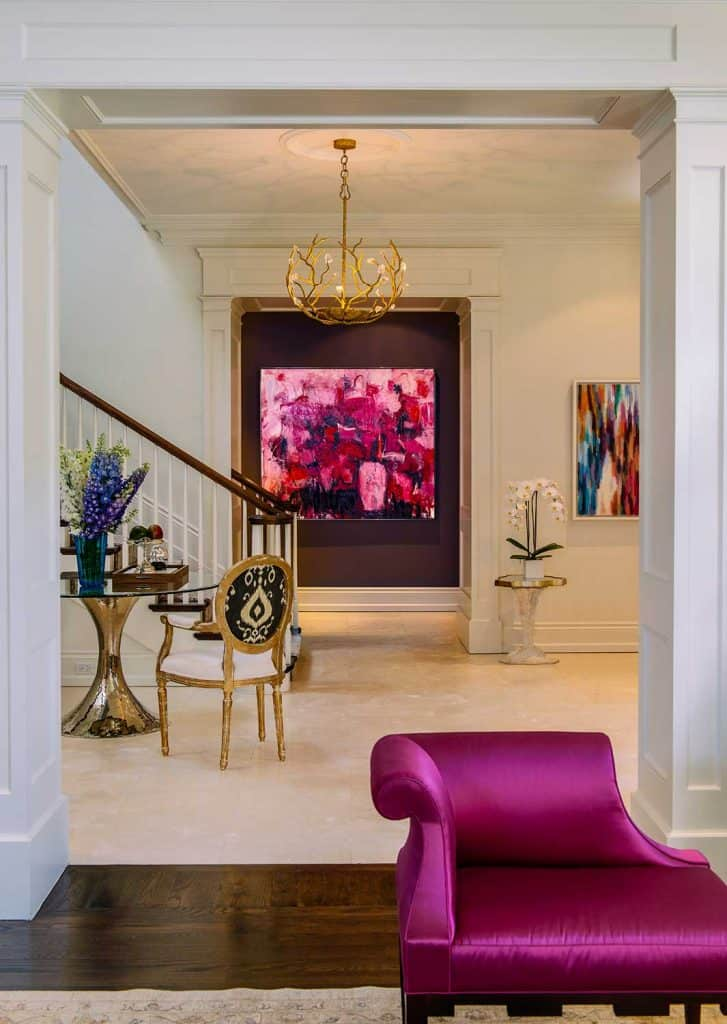 Foyer interior design with color coordinated furniture and fabrics, art work on the wall