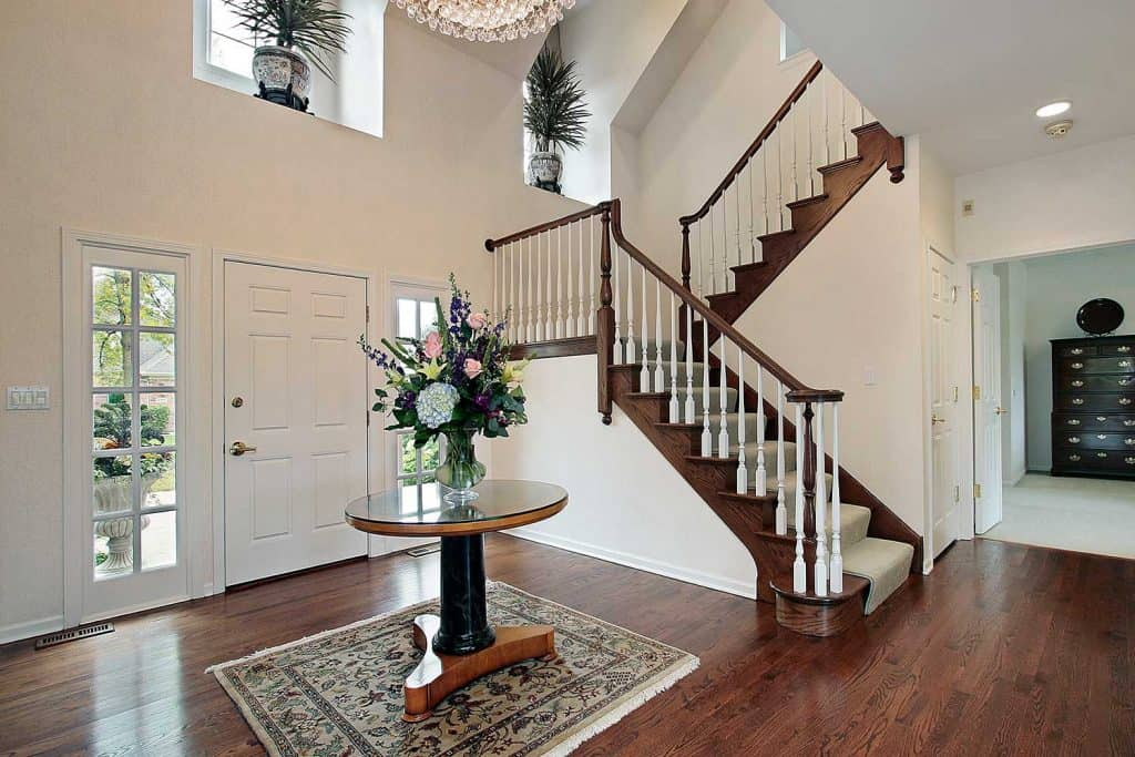 Foyer with center table and carpet rug