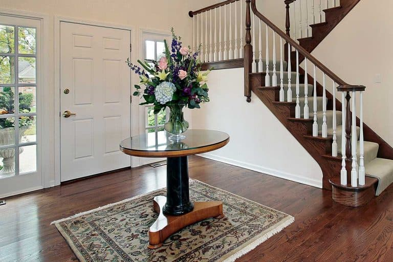 Foyer with center table on carpet rug, 11 Foyer Rug Ideas You're Going to Love