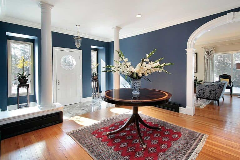 A foyer with white columns and round center table, Does a Foyer Count as a Room?
