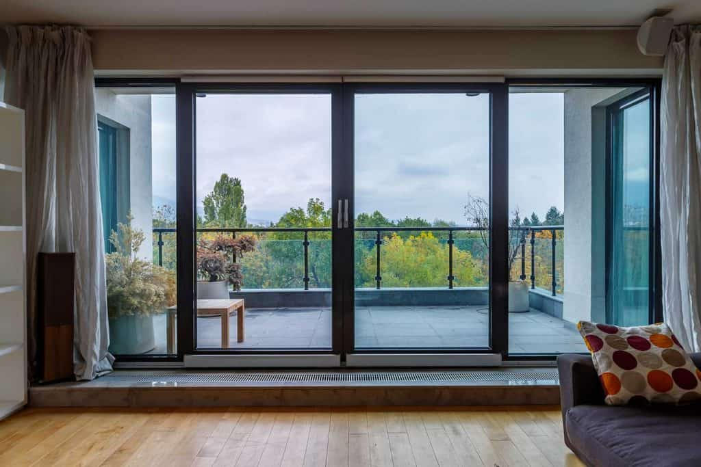 Glass sliding door of a balcony in a modern home