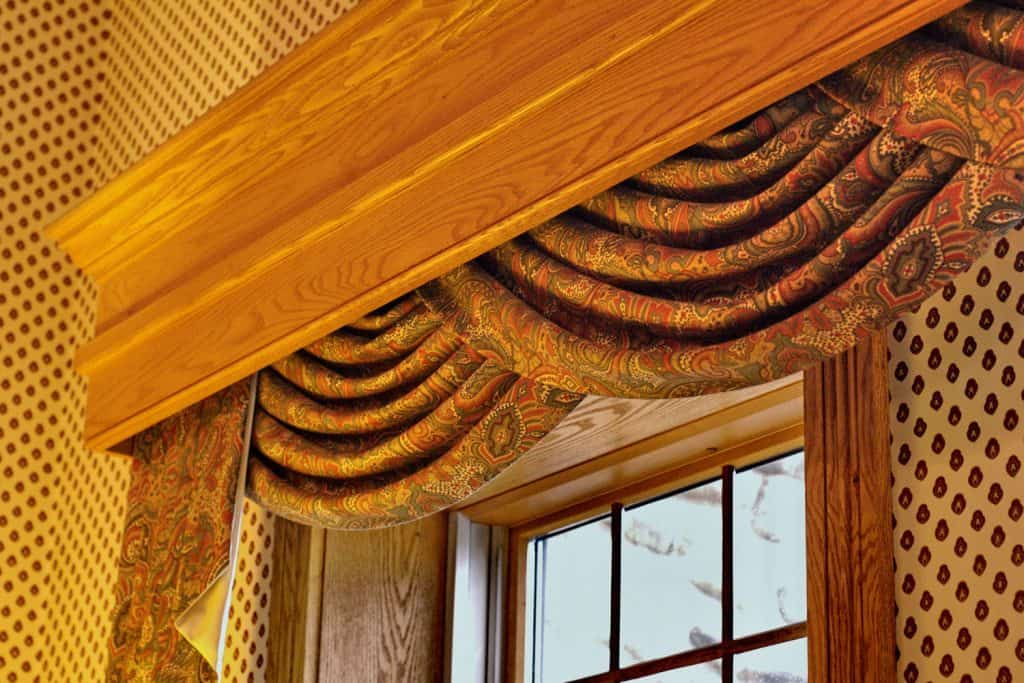 Gorgeous golden floral patterned swag curtains