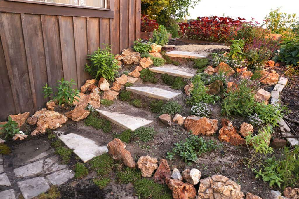 Gorgeous landscaping with rock and concrete steps