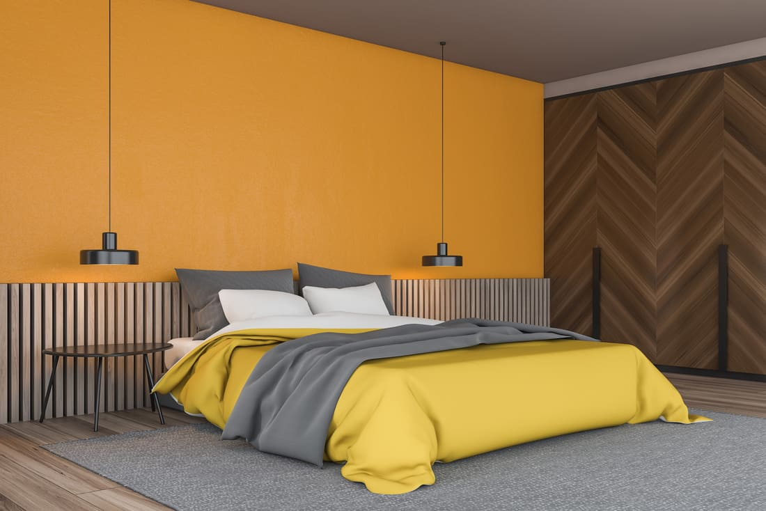 Gray carpet and yellow walls in a modern chic bedroom