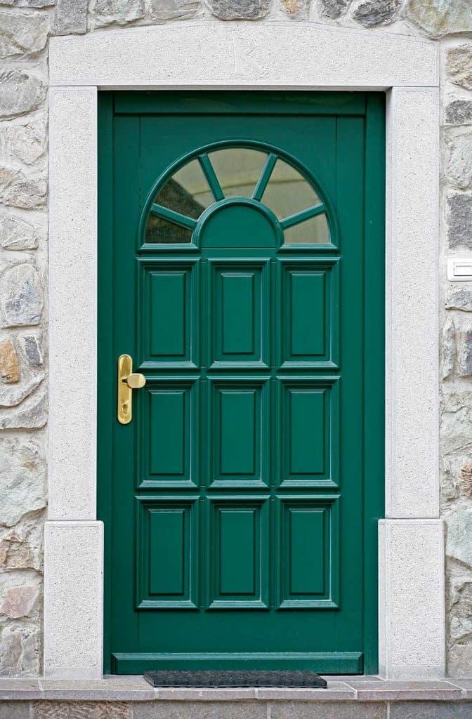 Green front door of a house