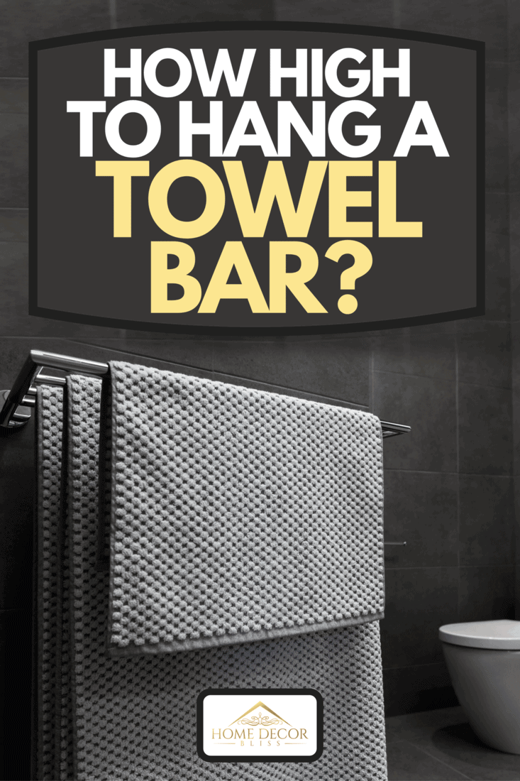 A close up of luxury bathroom towels in a monochrome ensuite bathroom, How High To Hang A Towel Bar?