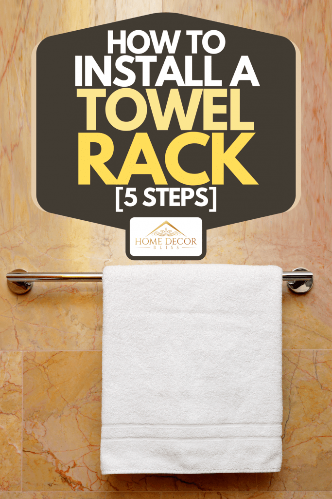 A white towel hanged on a towel rack in a modern bathroom, How To Install A Towel Rack [5 Steps]