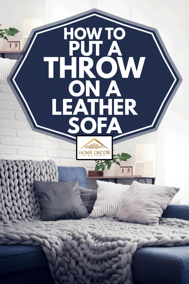 Gray knitted blanket from merino wool on couch with pillows in the interior of the living room, How To Put A Throw On A Leather Sofa