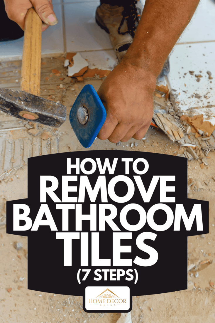 Man removing tile with hammer and chisel scraper, How To Remove Bathroom Tiles (7 Steps)