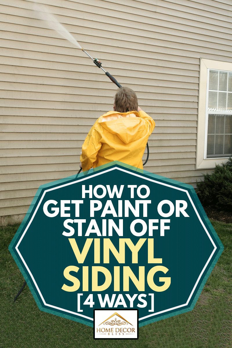 A worker pressure washing the siding of a house, How to Get Paint or Stain off Vinyl Siding [4 Ways]
