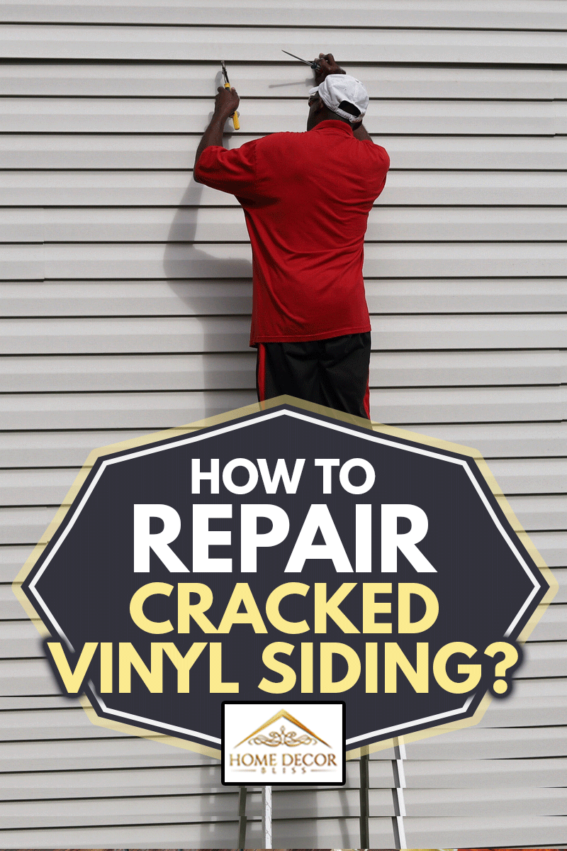An African-American man on a ladder and fixing cracked vinyl siding on a house, How to Repair Cracked Vinyl Siding?