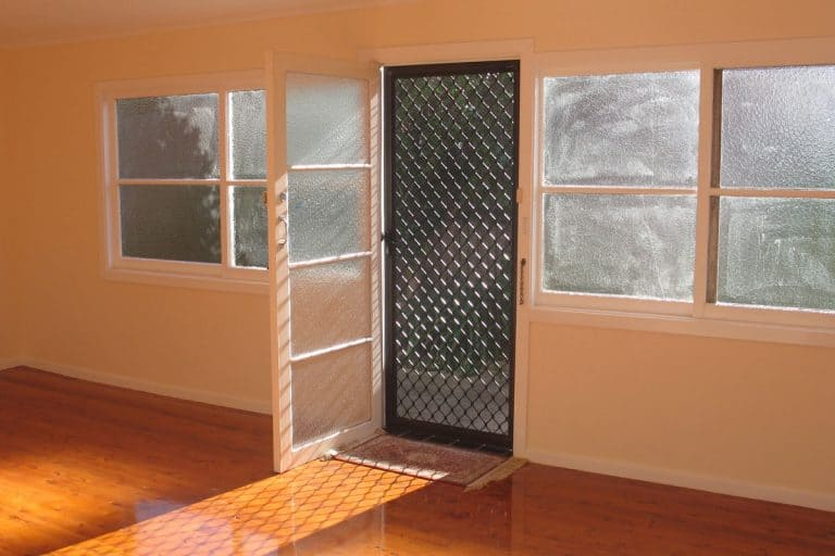 An interior of a small modern house with a screen door, How To Clean A Screen Door