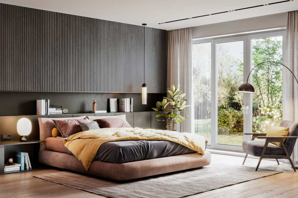 Interior of an ultra modern contemporary bedroom with a comfortable bed and a gray area rug