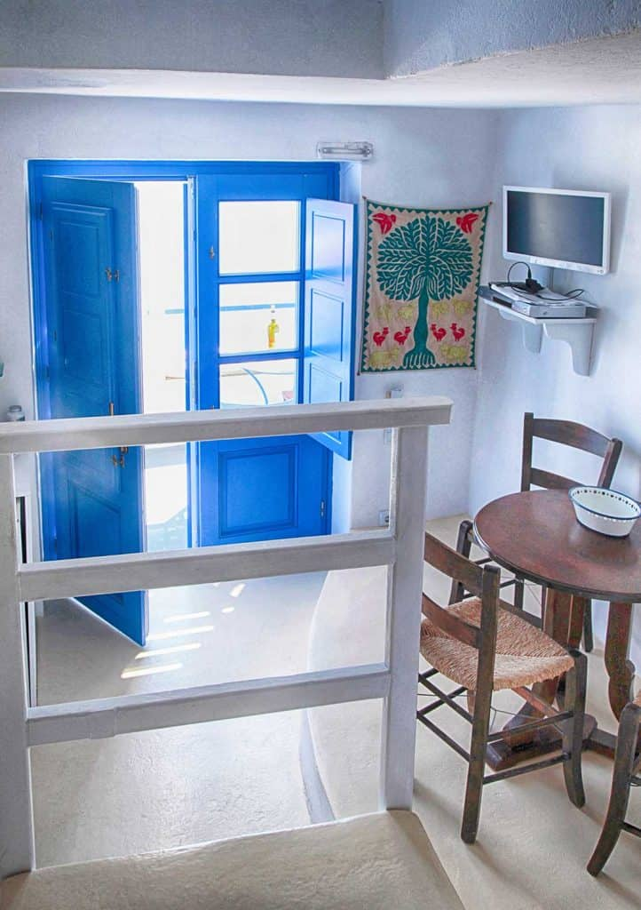 Interior of traditional house with wooden furniture and blue door