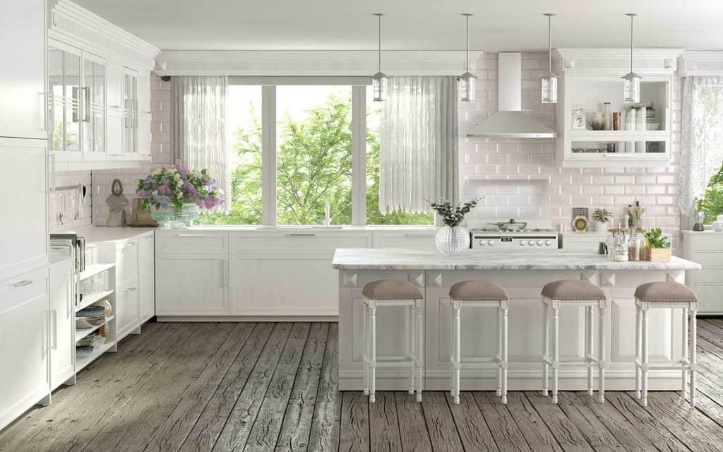 Kitchen interior design with island table, white brick walls and hardwood floor
