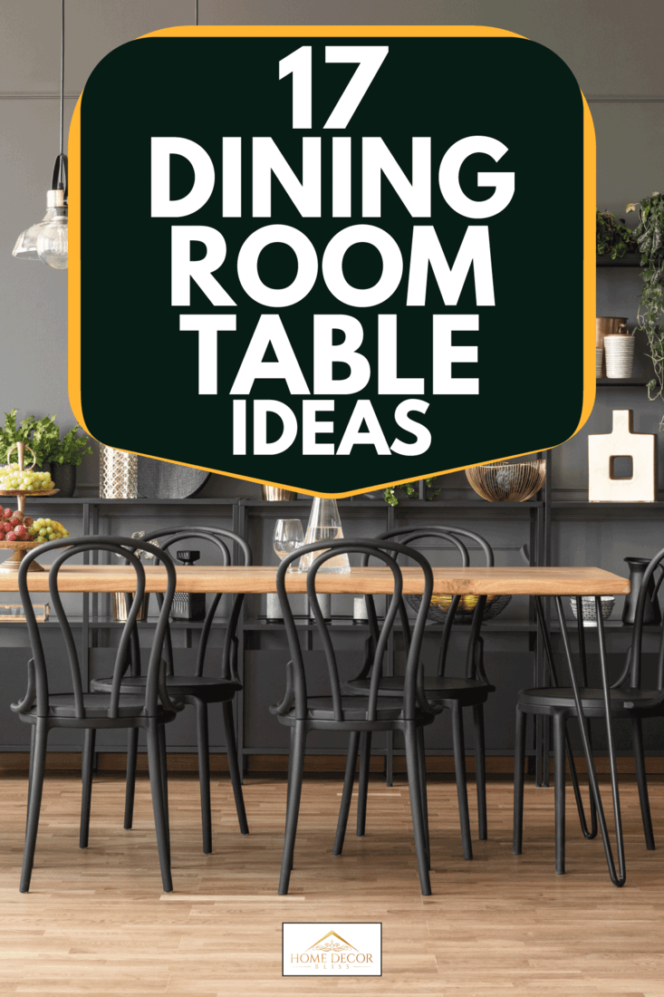 Lamps above wooden table and black chairs in gray dining room interior with plants, 17 Dining Room Table Ideas