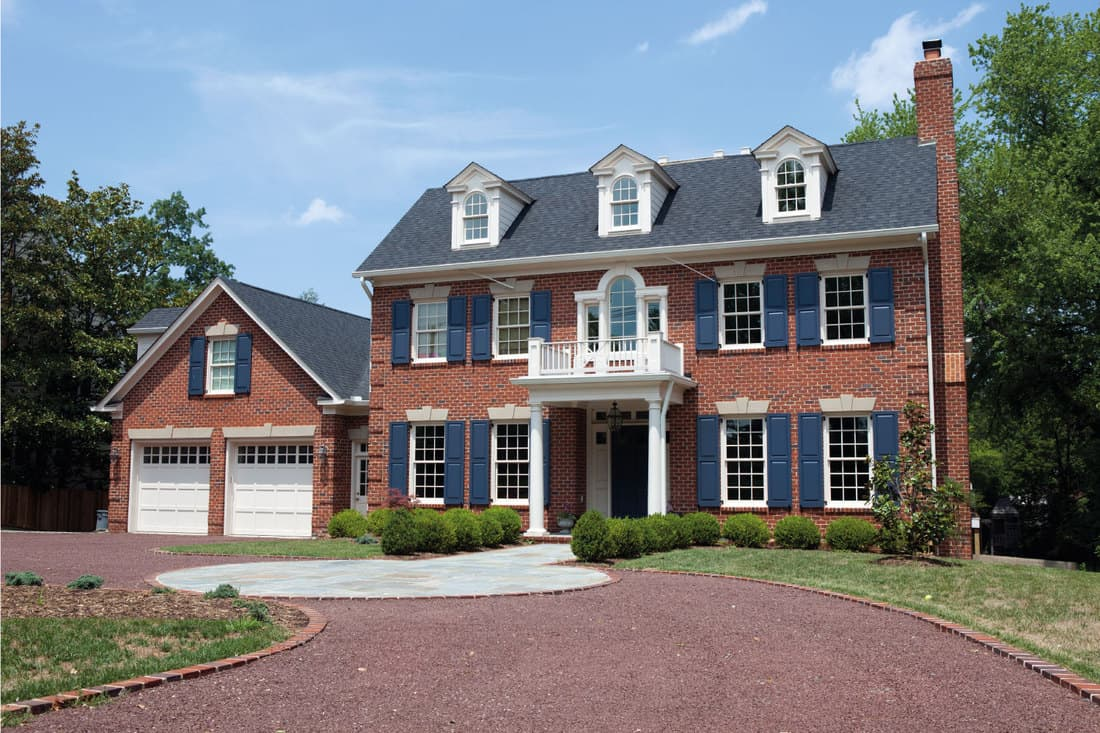 Large traditional home with front porch entryway