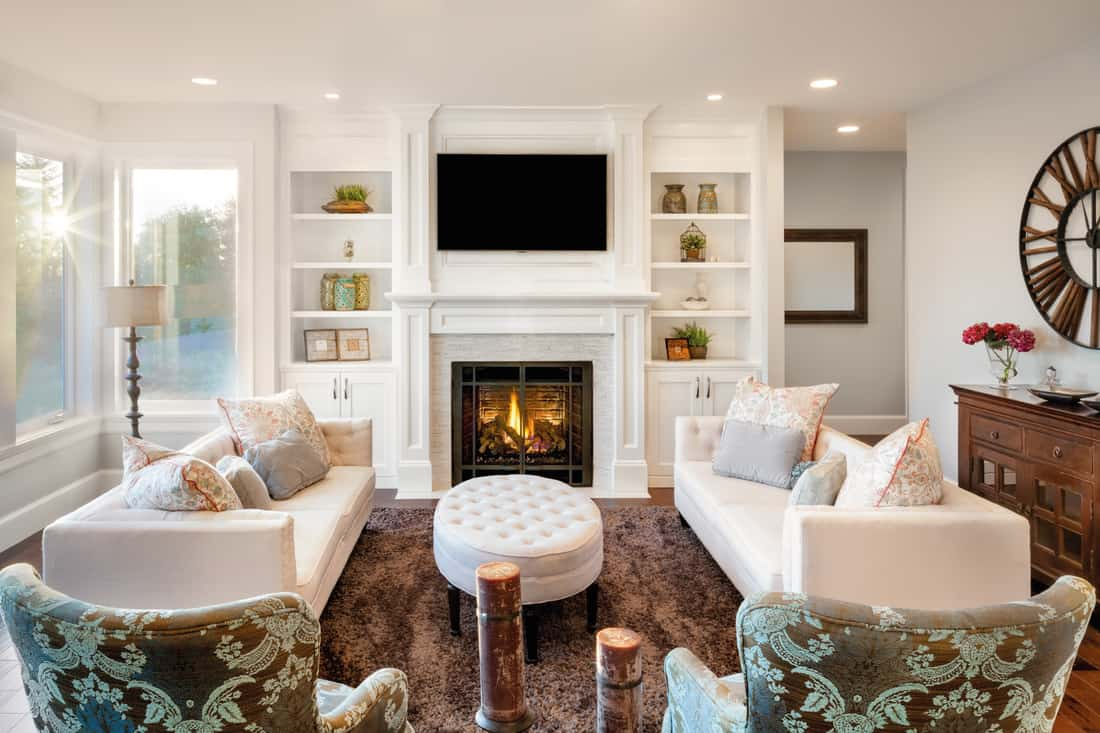 Living room with sun burst in luxury home, matching couches facing each other for symmetry
