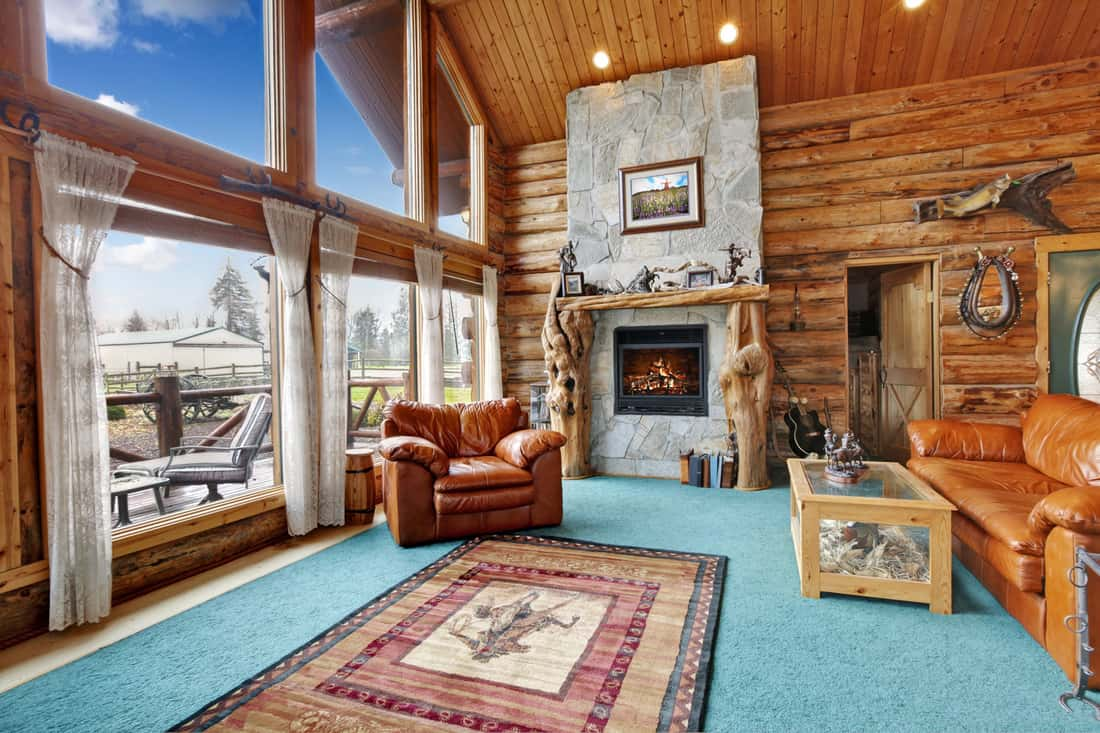 Log cabin living room with blues and greens