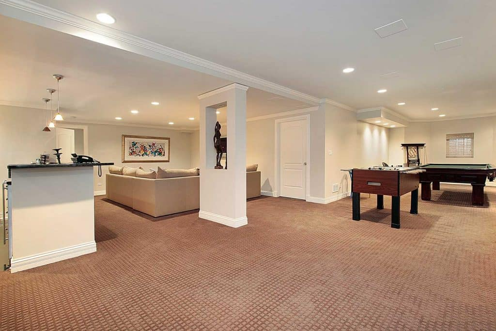 Lower level with pool table, carpet floor and sofa
