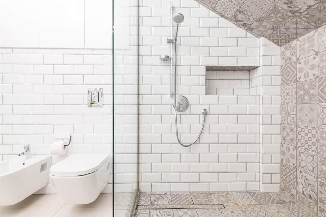 Luxury beige bathroom, sloped ceiling in a steam shower