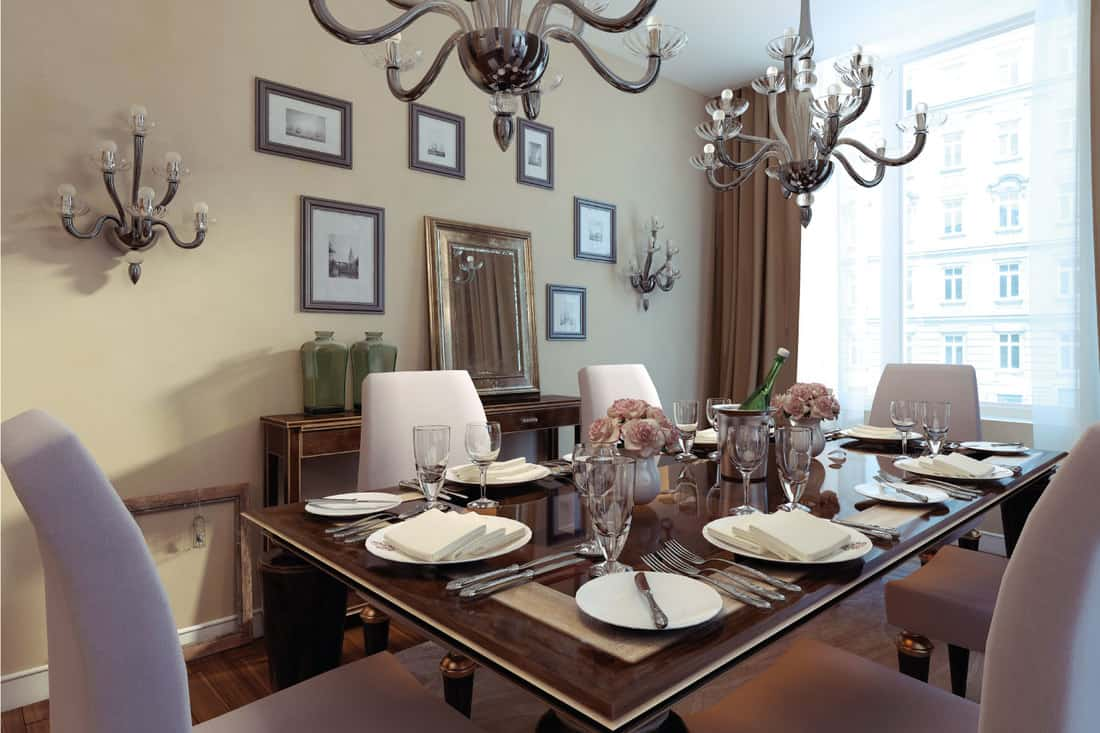 Luxury dining room, art deco style. dining room mirror with artworks on all sides, table is set for dinner