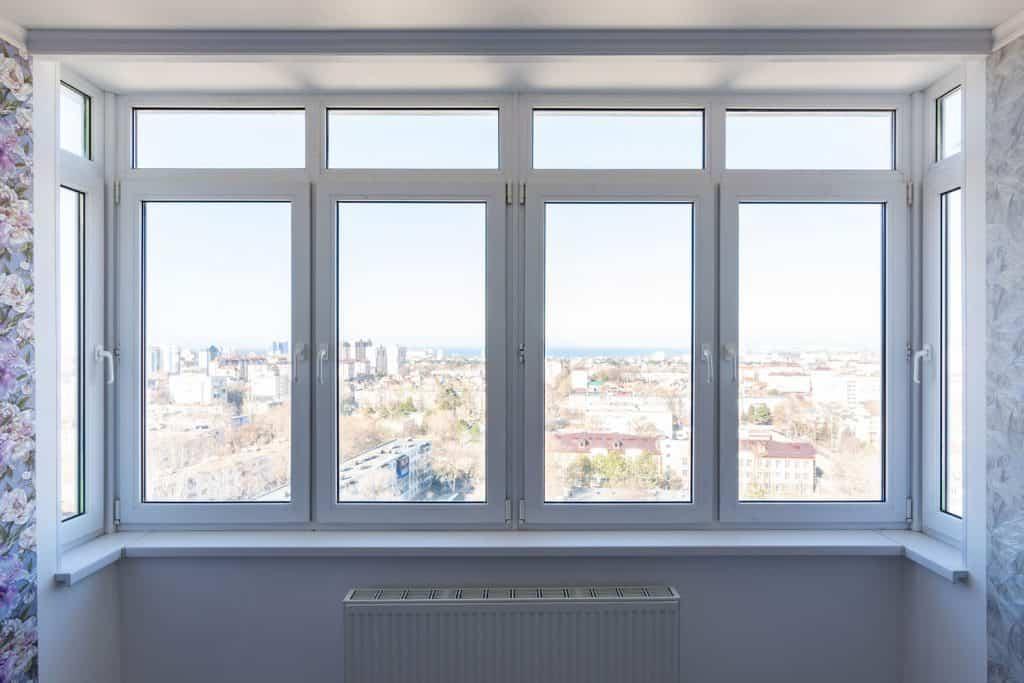Metal framed transom window of a modern contemporary living room