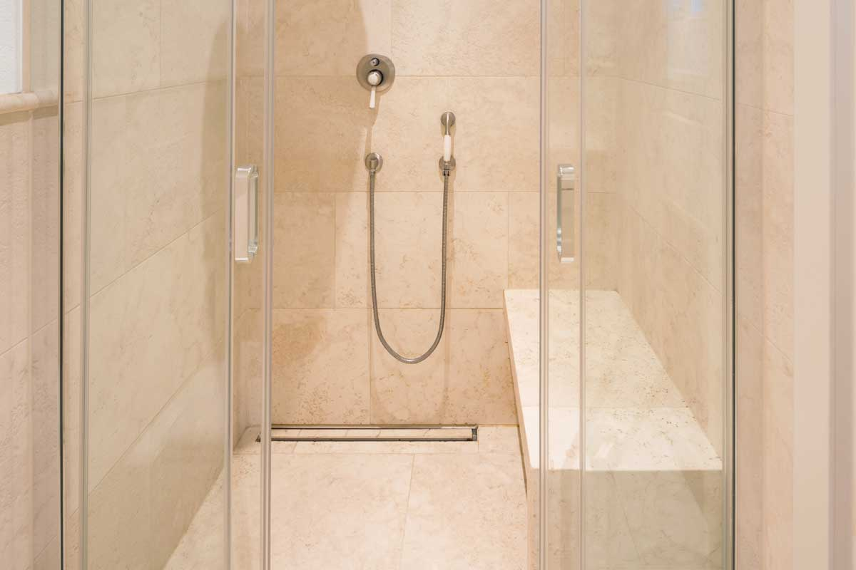 Modern bathroom with marble tiles, How To Clean Mold Off a Shower Bench